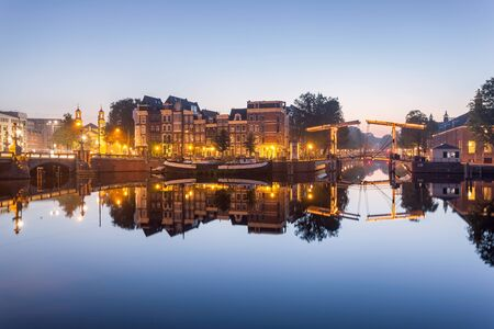 amstel: Magere cantilever lifting bridge on the Amstel canal in Amsterdam also known as the Skinny Bridge. Stock Photo