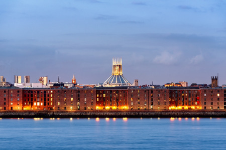 Liverpool waterfront skyline with its albert dock , ware houses and Anglecan cathedral, UK.