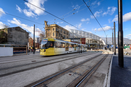 Manchester Metrolink tram leaving Victoria Station in England UK.