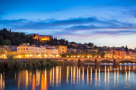 river arno: Panoramic view of Ponte alla Carraia firenze florence bridge which is a landmark on river arno. Stock Photo