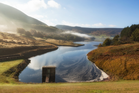 Spillway at the Dove stones reservoir with slightly mist and blue sky , Oldham, Saddleworth, UK Фото со стока - 78585416