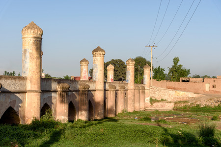 Mughal style arch bridge over the canal in suburbs of Peshawar city, Pakistan Editorial
