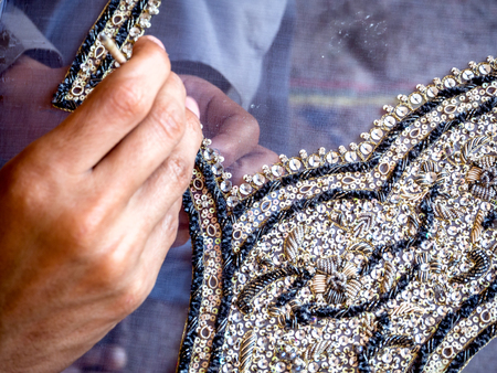 sequences: Elegant embriodery work in progress, a Traditional Craft of Pakistan