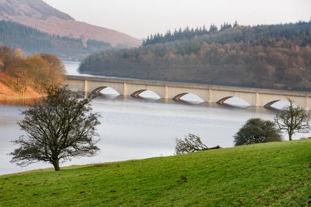Bridge over Lower Derwent Reservoir as it joins Ladybower Reservoir in Peak District National Park, Derbyshire, England, UK
