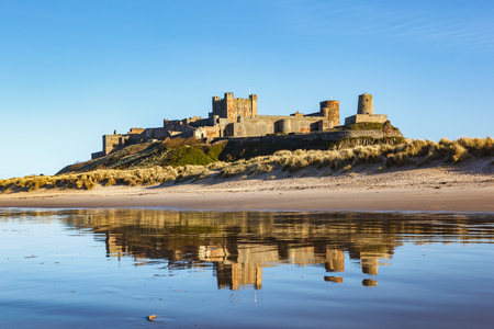 Reflection of a Bamburgh castle with clear blue skyline on Northumberland coast, England. Editorial