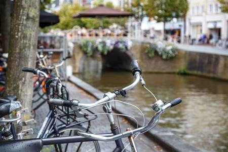 Row of a bicycles  parked in front of a canal in Leewarden, Netherlands