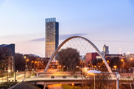 The Hulme Arch Bridge and Beetham Tower on a skyline of  Manchester, England.