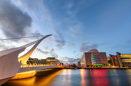 Barrel shaped Dublin Convention Center and Samuel Beckett Bridge reflecting in the river Liffey, Dublin , Ireland