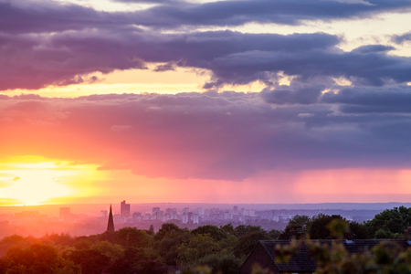 Dramatic sunset over Manchester with clody skyline, England, Europe Stock Photo