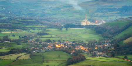 View of castelton and the Cement Works Factory In The Hope Valley, The Peak District Derbyshire England UK