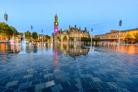 Vast mirror pool splashed by 107 fountains now glistens beside the Victorian city hall, Bradford, UK Editorial