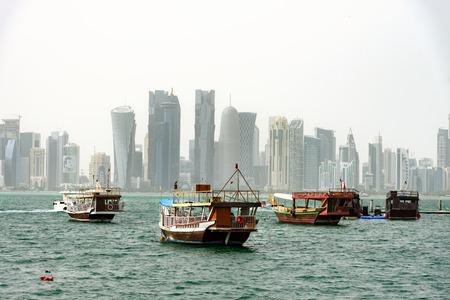 Doha skyline and passender boats at bay