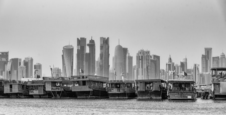 The traditional wooden boats or dhows and the skyscrapers of the Gulf can be seen along Doha Corniche,