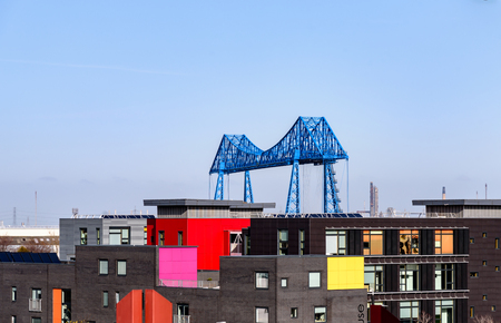A blue transporter bridge above colourful buildings in Middlesbrough UK