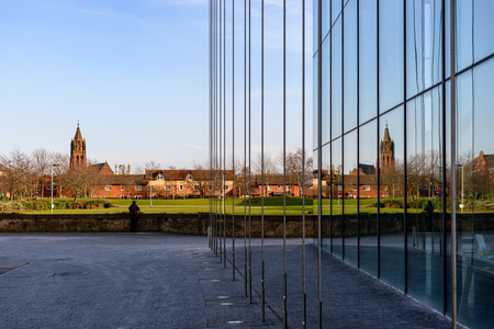 Reflection of church in the windows of a glass building in Middlesbrough, UK Stock Photo