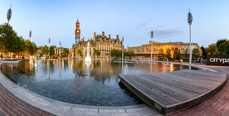Regenerated urban park, now with huge mirror pool, 100 fountains, light projectors and mist effects in the city centre Bradford, UK.