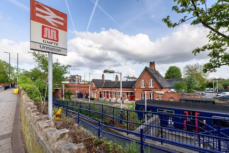 A new building on the Manchester-bound platform houses the ticket office and a waiting room. Stock Photo