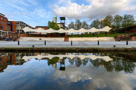 Facade view of Castlefield Bowl event arena and its reflection in crystal clear water, Manchester, UK Editorial