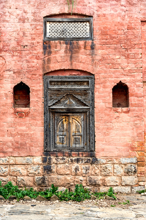 Facade view of traditional window with beautiful artwork, Pakistan. Stock Photo