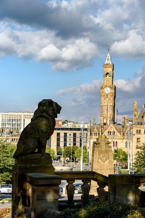 Silhoutte of lions statute in front of town hall building in Bradford city, UK.