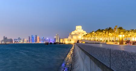 The museum is built on an island off an artificial projecting peninsula near the traditional dhow  harbor in Doha Qatar. Stock Photo