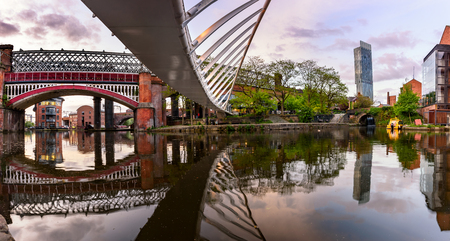 The canal basin at Castlefield is crossed by four large railway viaducts