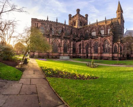 The sandstone exterior (from the south west) has much decorative architectural detail but is heavily restored of Chester Cathedral in Chester, UK.