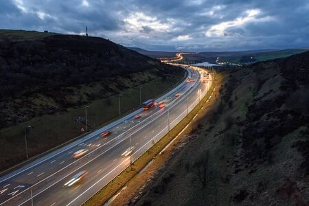 Light trails on M62 at night near Leeds, West Yorkshire, UK.