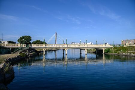 A cable stay bridge built in 2004 across the Marine Lake. Very modern bridge in a Victorian town of Southport UK. Stock fotó