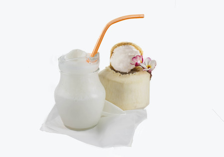 stirred: Coconut smoothie on a white background Stock Photo