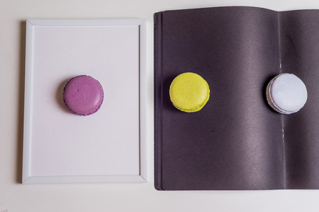 specialities: French Macaronsons on black Paper and white paper