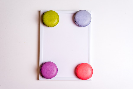 favor: French Macaronsons on white frame isaolated over white Stock Photo