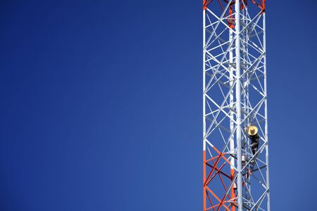 man painting on telecommunication tower  photo