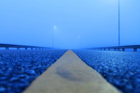 road covered in fog photo