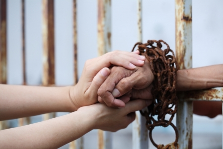 women hand holding prisoner hand  Archivio Fotografico