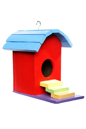 colorful bird house isolated on white background  写真素材