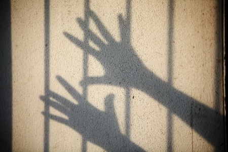 shadow of hand in jail Stock Photo - 20981868