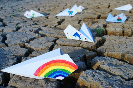 colorful paper airplane on ground. photo