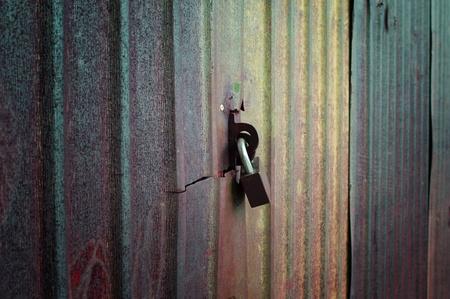 Closeup metal door with lock in grungy style  photo