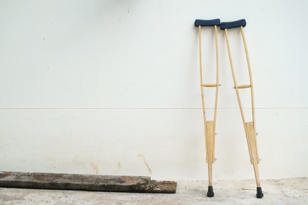 crutches at white wall  写真素材