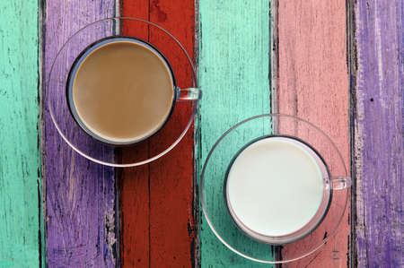 coffee and milk on colorful wooden panel  photo