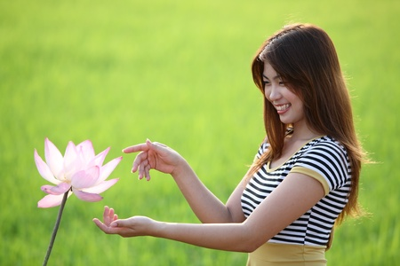 beautiful girl with lotus flower  photo