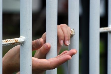 hand in jail  Stock Photo - 21057224