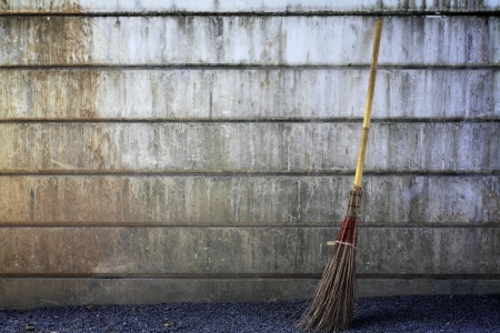 broom with grunge wall