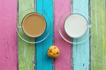 milk,coffee and muffin on colorful background  photo
