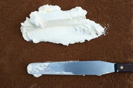 slicing cream on cake  photo