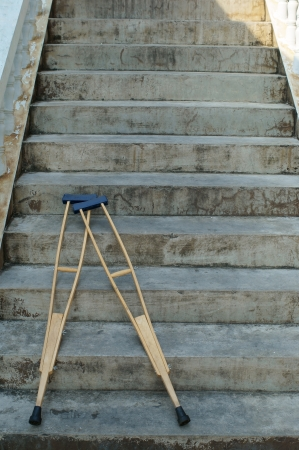 broken up: crutches lay down on stair  Stock Photo