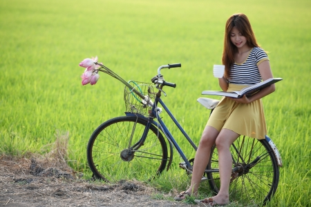 girl reading the book with green background  photo
