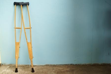 crutch: crutch on wall. Stock Photo
