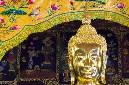 buddha head: golden buddha head with chinese wallpaper